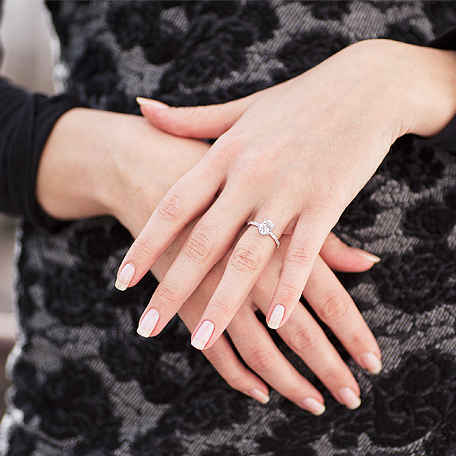 Woman wearing a big diamond ring.
